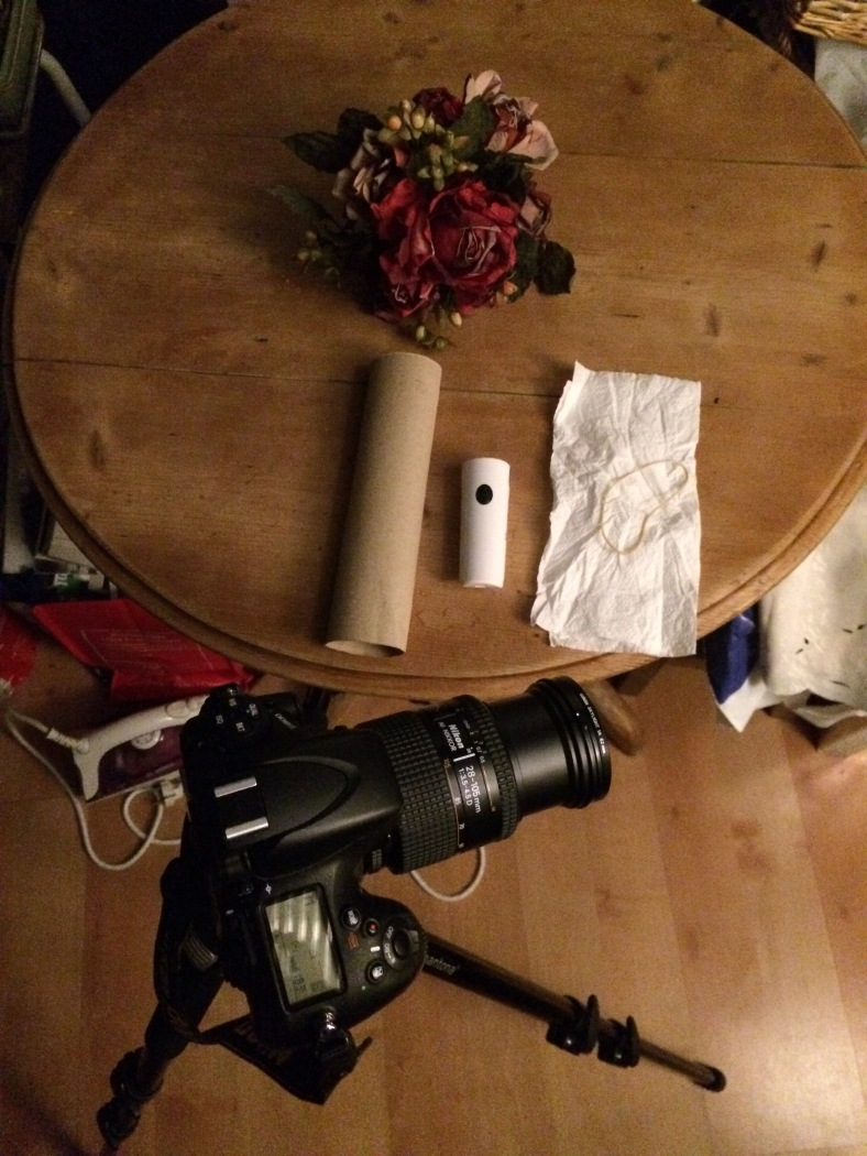 here is what I used to take the photos for this post . My camera, a tripod, a paper towel tube, a white paper towel, an elastic and a led flashlight.